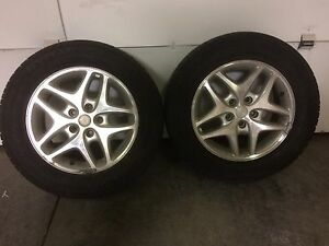 2 tires on aluminum rims size 225/60/16   $100 for both obo