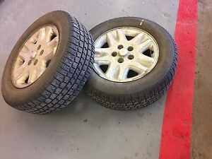 Pair of winter slalom on dodge caravan wheels