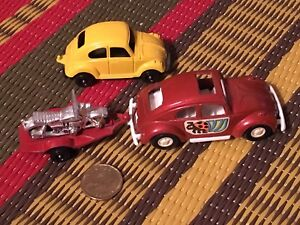 Two vintage Tootsietoys VW Beetle toy cars