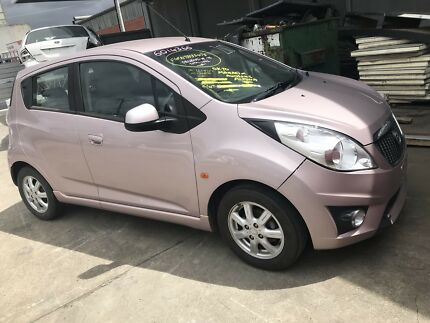 Wrecking 2010 Holden Barina Spark Hatchback in Pink colour