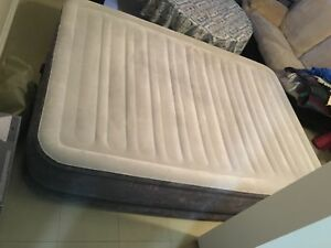 Double size air mattress with built-in pump