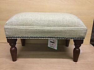 Footstool upholstered in a Laura Ashley fabric Dalton natural