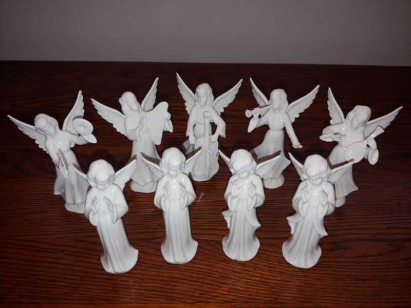 Vintage 9 piece porcelain Dresden choir Christmas angels. No chips.