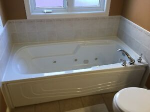 Jacuzzi whirlpool bathtub by Tomlin