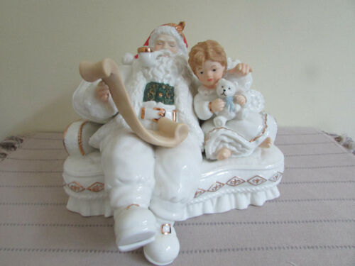 "HERITAGE MINT 2003 SANTA ON COUCH WITH CHILD FIGURINE 10""W"
