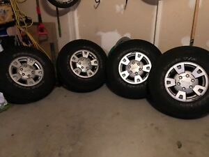 "STOCK GMC 15"" RIMS + BF GOODRICH LONG TRAIL T/A"
