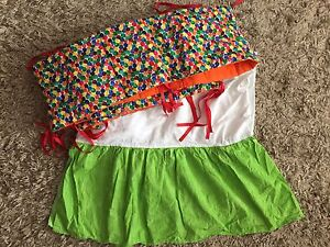 Hungry Caterpillar themed bumper pads and crib skirt
