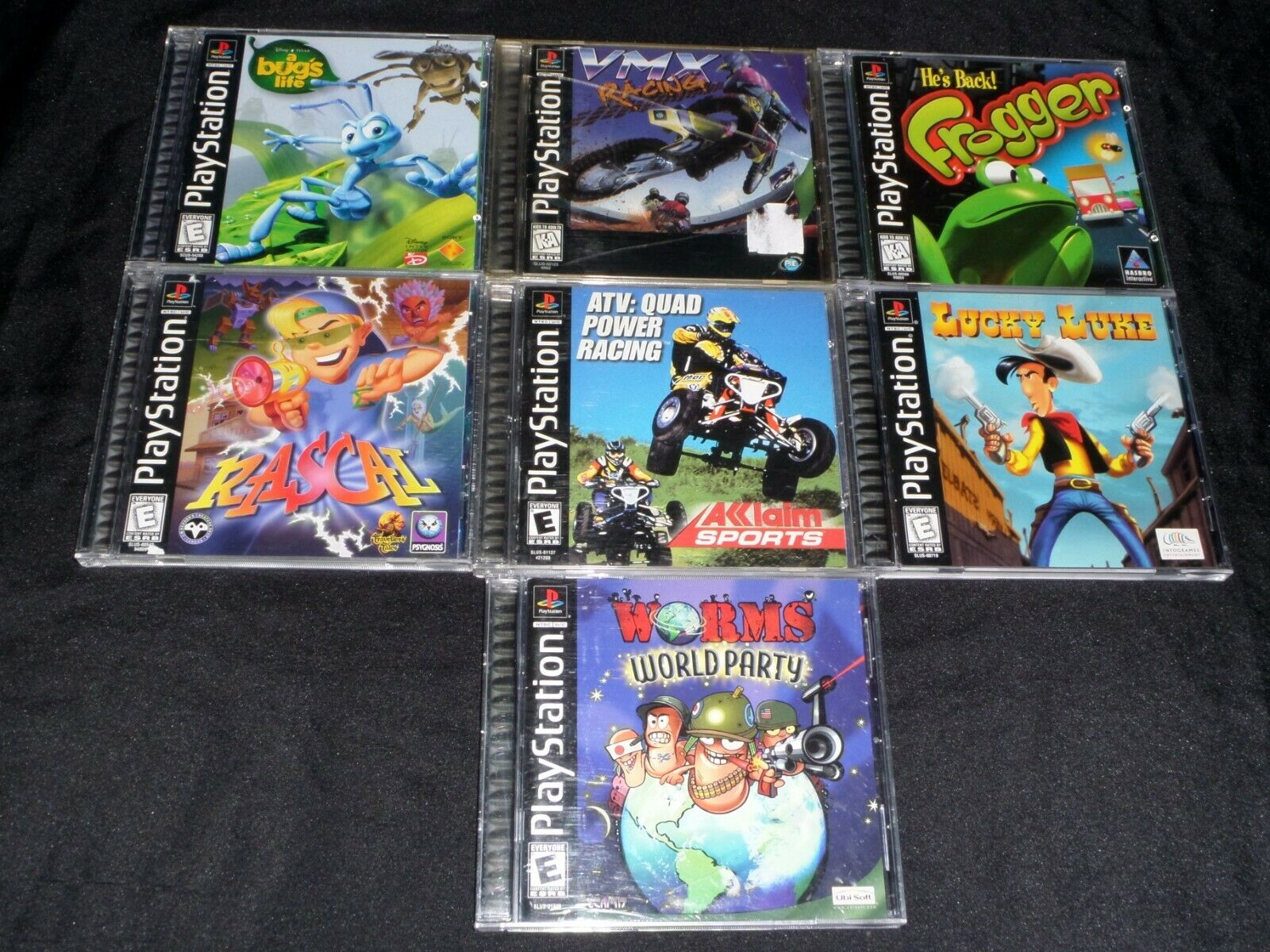 Lot Of 7 PS1 Games CIB COMPLETE - Lucky Luke, Rascal, Worms World Party, Frogger - $45.00