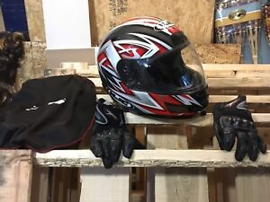 Two Motorcycle helmets and a pair of gloves