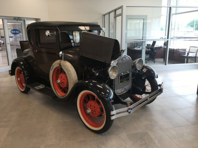 Ford: Model A Special Coup 1929 model a special coupe brown with seat belts rebuilt collectors sold