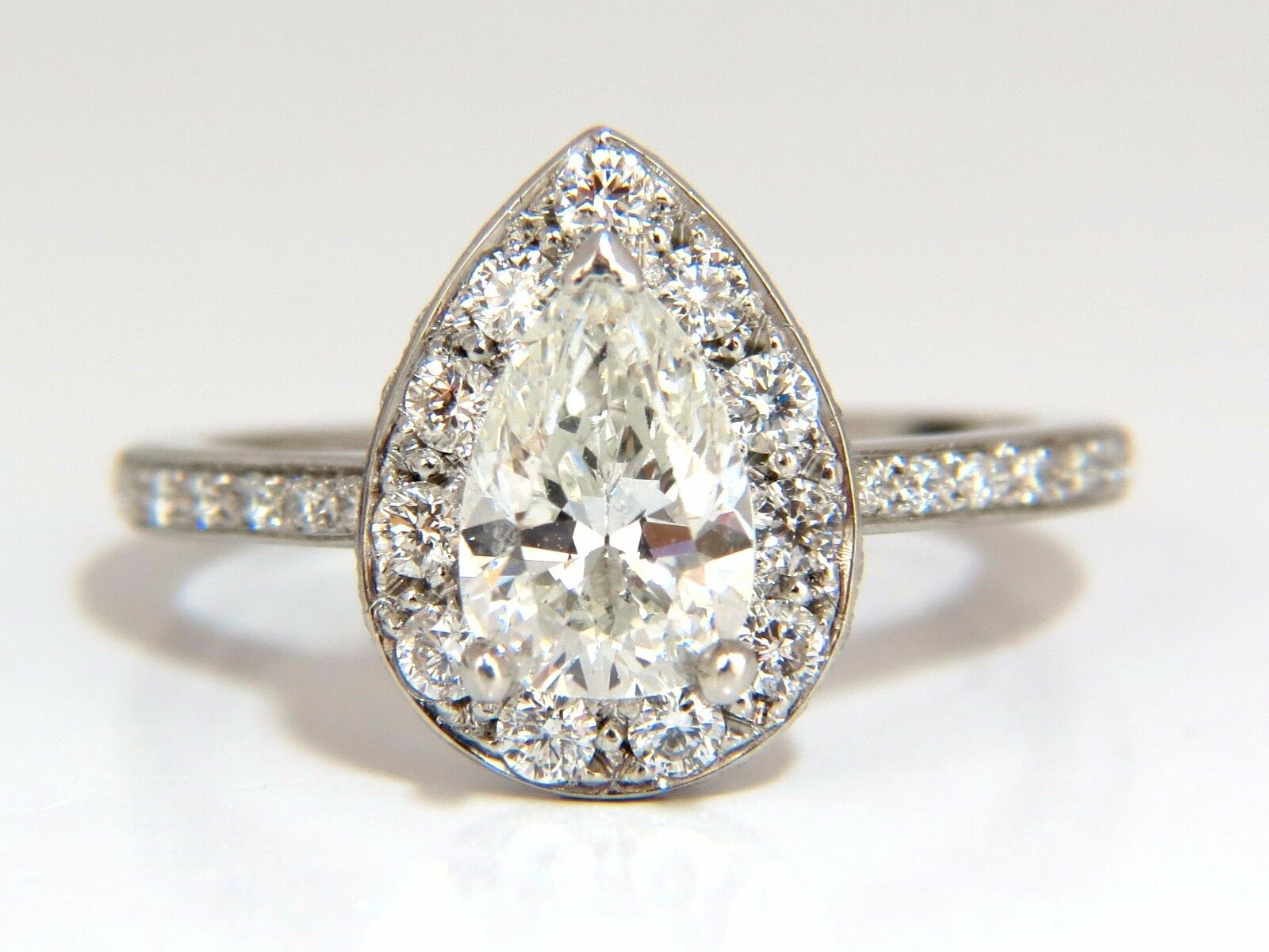 GIA Certified 1.15ct Pear Shape diamond ring 1.00ct. round accents platinum+