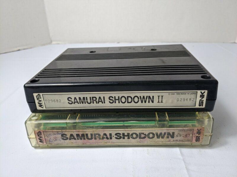 NeoGeo MVS Samurai Shodown 1 and 2 original. Issues with both. Water damage desc