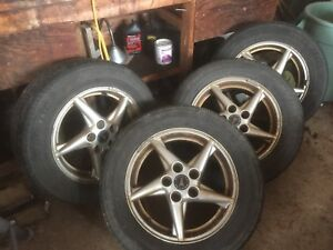 4 alloy wheels with all season tires