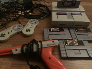 Super Nintendo with sunset riders, Mario all stars, and more!