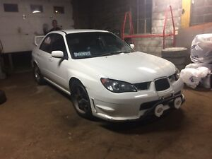 LOOKING TO TRADE BOTH MY CARS