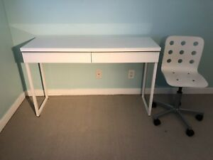 IKEA desk and white swivel chair