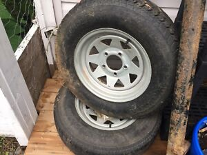 TWO TRAILER TIRES ON RIMS