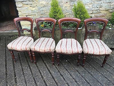 A Set of Four Victorian Carved Mahogany Dining Chairs