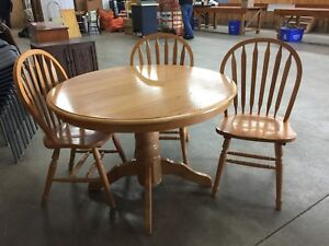 Solid wood table and three chairs.