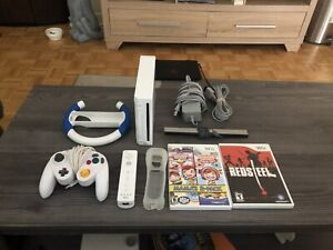 Nintendo Wii + 2 Games & Controllers