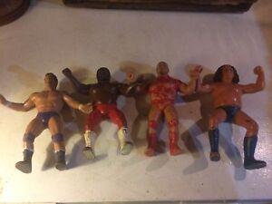 """Vintage rubber 8"""" WWF wrestling figures."""