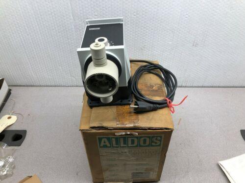 NEW IN BOX ALLDOS METERING PUMP (CORD SET GRIP DAMMAGED) M190