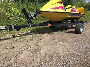 Two single seadoo trailers looking to trade for double aluminum