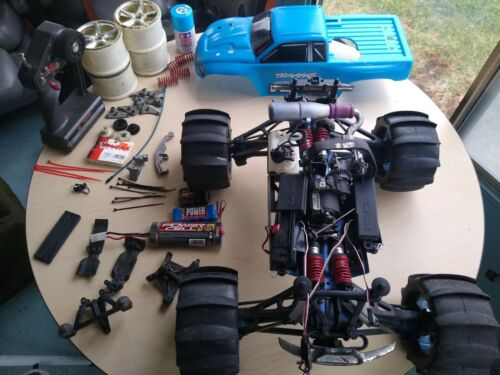 TRAXXAS REVO 2.5 3.3 ROLLING CHASSIS PARTS LOT PADDLE TIRES TX RX SERVOS Tmaxx