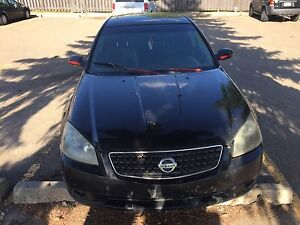 Black Nissan Altima 2003 project car , black seats, black rims.
