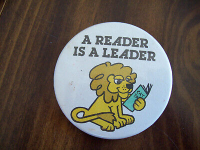 A READER IS A LEADER LION 2 AND A QUARTER INCH OLDER PIN