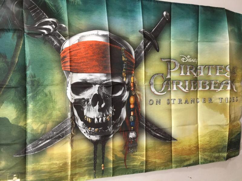 Disney PIRATES OF THE CARRIBEAN flag NOS Stranger Tides Skull Crossbones Swords
