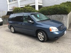 2006 Ford Freestar, Electric Wheel chair & 4,000lift  included.