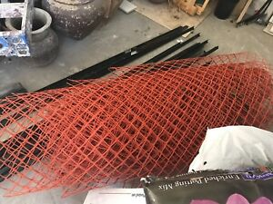 Plastic fencing , metal stakes and 10 8ft 2 x 4