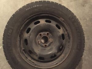 Michelin X-ice winter tires with steel rims.  195/65/R15