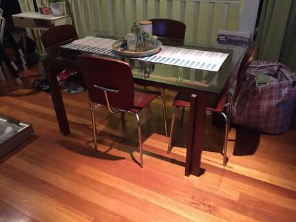 Glass top dining table with matching seats