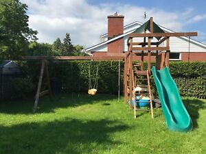 Wood swing set with slide and monkey bars