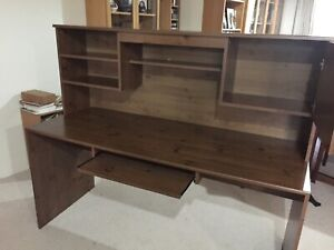 Desk with hutch  dark stain wood grain finish. 3 dr