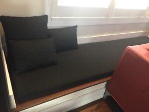 7 ft long black cushion and pillows
