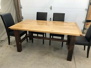 Dining table with rustic barn beam base