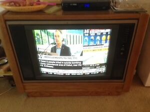 Retro style CRT tv in a wooden housing