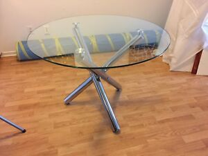 Stylish round glass top dining table