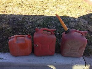 Three gasoline cans