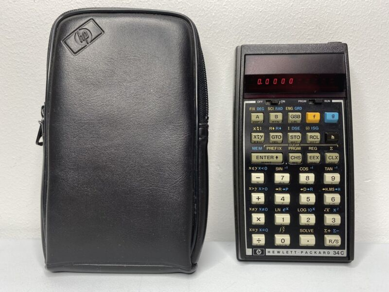 HP 34C Hewlett Packard Calculator with leather case. Excellent Condition WORKS!