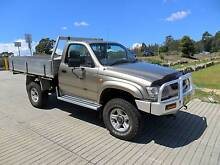 2005 TOYOTA HILUX 4X4 DUAL FUEL SINGLE CAB MANUAL UTE GOLD Lansvale Liverpool Area Preview