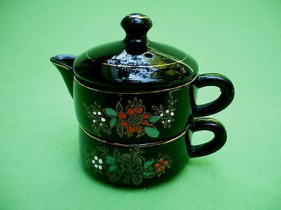 Vintage Japanese teapot and cup in one. Jet black with raised paint flowers. Exc