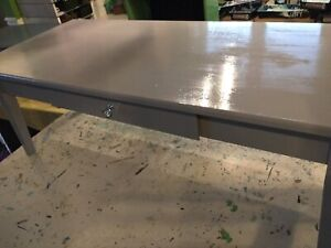 Grey coffee table with drawer-
