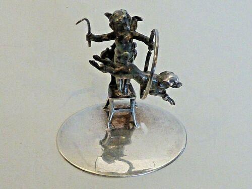 MINIATURE CUPID & DOG PERFORMING FIGURES, 1898 CHESTER IMPORT, HANAU STERLING