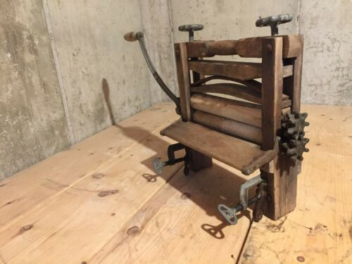 Vintage wooden clothes wringer with hand crank