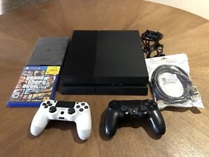 PS4 CONSOLE WITH 2 CONTROLLERS & 2 GAMES!