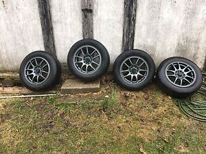 Four 15 in Rims and tires